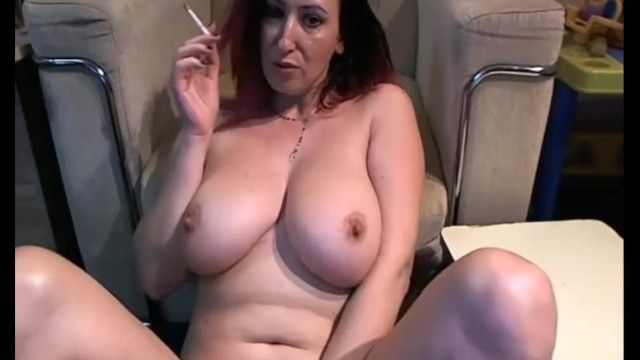 Milf with large mangos hanging out smokin