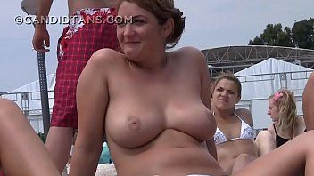 Large breasty topless sweethearts on the beach