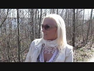 Blond large tit milf give irrumation in woods