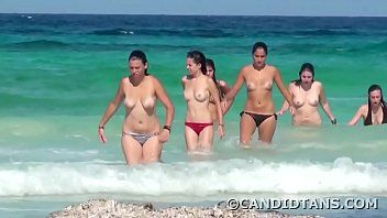 Topless nubiles on the beach showing whoppers in public